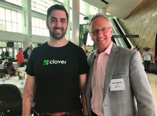 Sam Gimbel (left), senior director of product management at Fiserv and Dan Bjerke, senior vice president of Clover Business Solutions at Fiserv Forum to launch a new Clover point-of-sale system.
