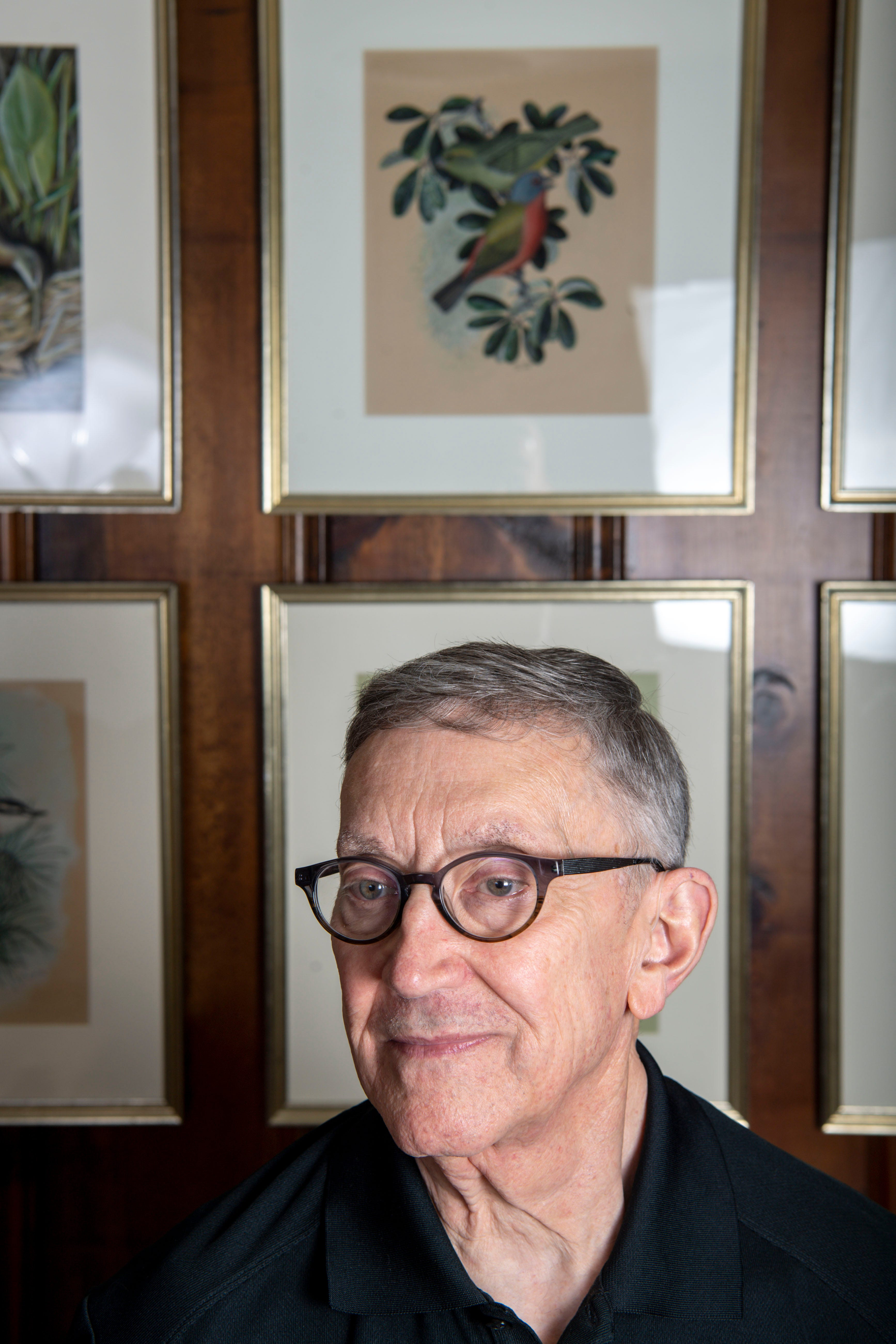 Earl Henry, Jr., is pictured in front of a collection of paintings done by his father Earl Henry, Sr., who was lost at sea when the U.S.S. Indianapolis was hit by Japanese torpedoes in 1945, at his home in Belle Meade, Tenn., on Monday, July 19, 2021.