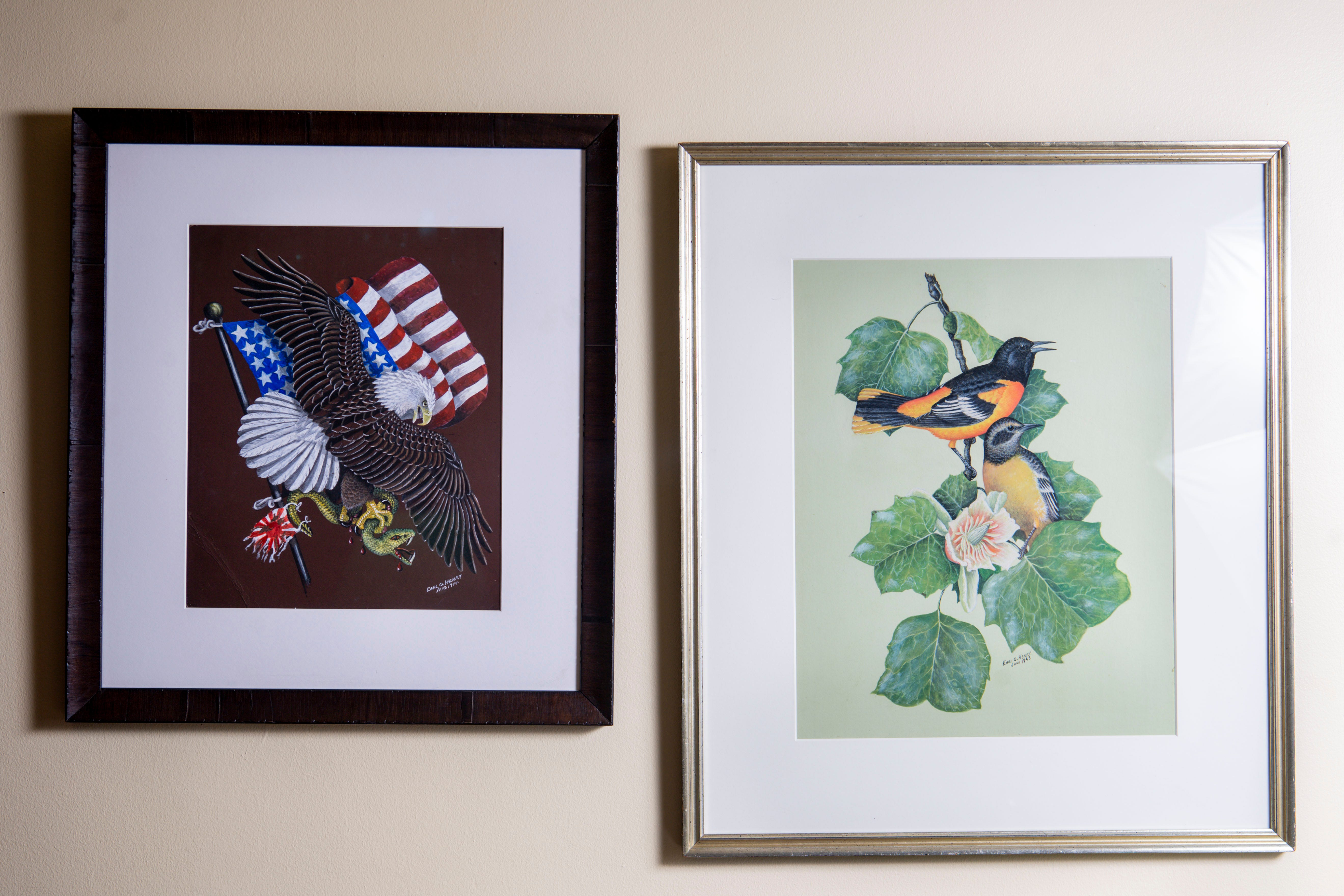 Paintings created by Earl Henry Sr. while he was serving in the Navy during World War II are seen on display in his son Earl Henry Jr.'s home in Belle Meade.