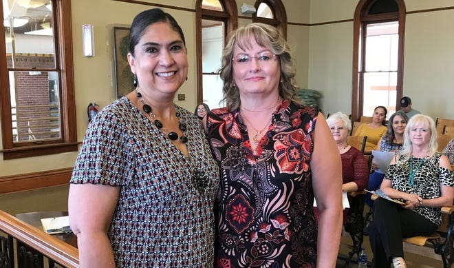 At right, Luna County Treasurer Kristie Hobbs presented Lisa Maynes with a 15-year service award. Hobbs commended Maynes for diligent work in the Treasurer's Office. Hobbs said Maynes was dependable, trustworthy and an asset to the Luna County Government.