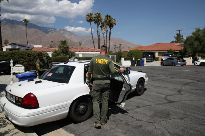Riverside County Sheriff Deputies take several people into custody for reasons not yet known as FBI agents investigate inside a home on Deepak Road in Palm Springs, Calif., on July 19, 2021.