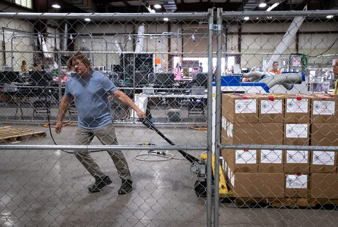 Cyber Ninjas attorney Bryan Blehm moves a pallet of ballots, July 19, 2021, in the Wesley Bolin Building at the Arizona State Fairgrounds, Phoenix, Arizona.