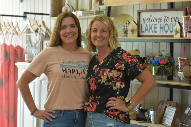 Marla McMillan, left, and Gail McWatters have teamed up to bring fresh flowers to McWatters' downtown Genoa shop,  Makers on Main – Threads and Grace Boutique & Co. McMillan owns Marla's Flower Truck.