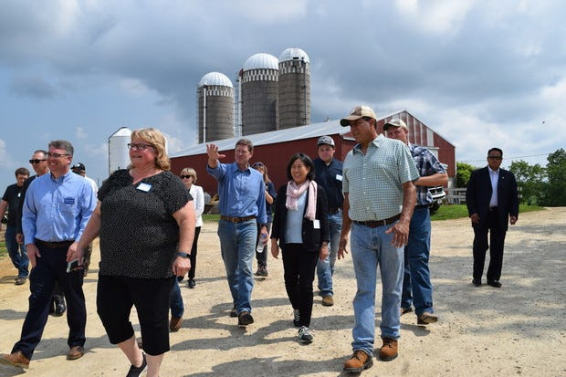 U.S. Trade Representative Katherine Tai, center, and U.S. Rep. Ron Kind (D-La Crosse) tour the Servais family's dairy farm in Stoddard, Wis. on Friday, July 16, 2021.