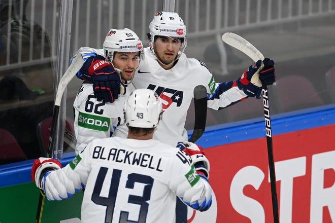 Matthew Beniers, right, congratulates Kevin Labanc, left, during the IIHF Men's Ice Hockey World Championships.