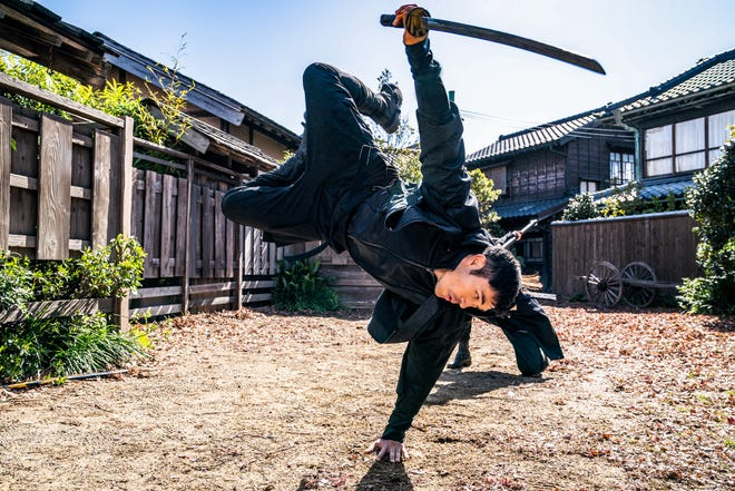 """Henry Goulding does some sweet martial-arts moves in """"Snake Eyes"""" with sword in hand."""