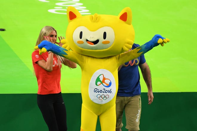 """Rio Olympic mascot """"Vinicius"""" waves to the crowd during the men's qualification in the Rio 2016 Summer Olympic Games at Rio Olympic Arena."""