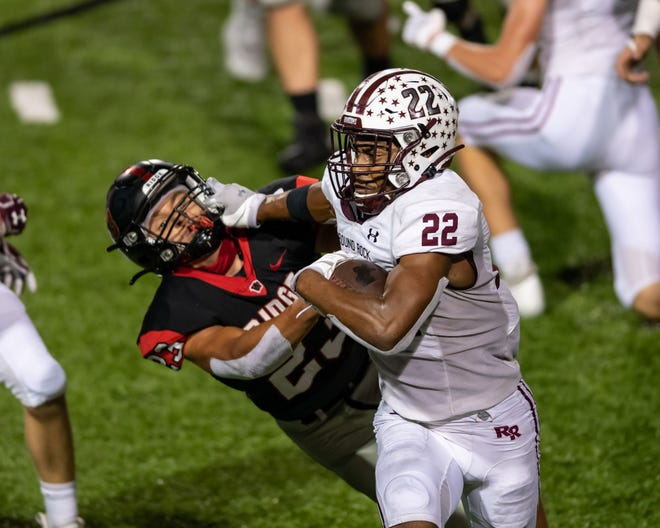 """Cedar Ridge's Jonathan Clark, left, brings down Round Rock's Israel Morgan in a district game last season. Clark, a 6-foot, 195-pound senior whom the coaches call """"a field general,"""" is the lone first-team, all-District 25-6A defensive back in 2020 to return this season."""