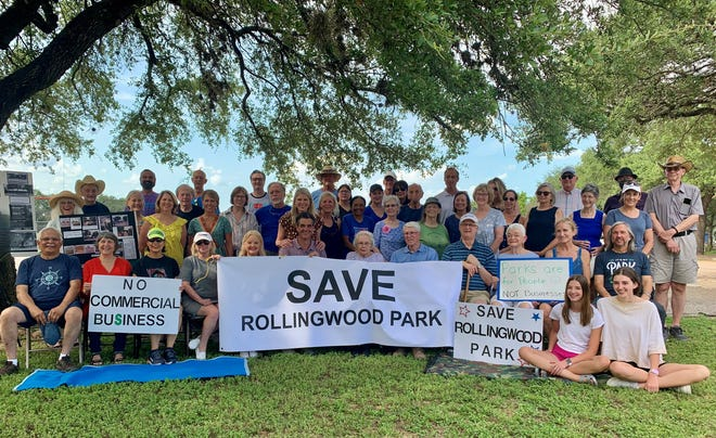 Residents whose homes are across the street from Rollingwood Park put out a call to neighbors to show their support for preserving their park as it is by posing in front of the park on earlier this summer.
