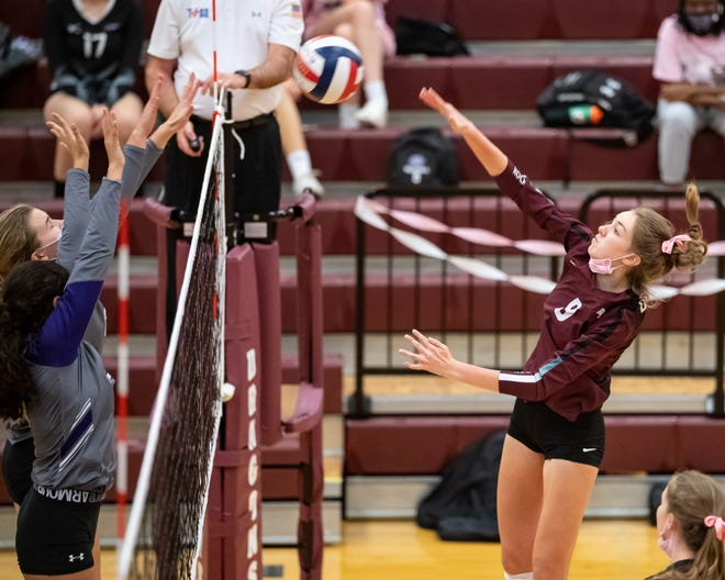 Round Rock's Lauren Murphy fires a shot over the net against Cedar Ridge in a match last season. Murphy, an incoming junior for the Dragons, and her Austin Juniors club team won a national title in Las Vegas earlier this month.