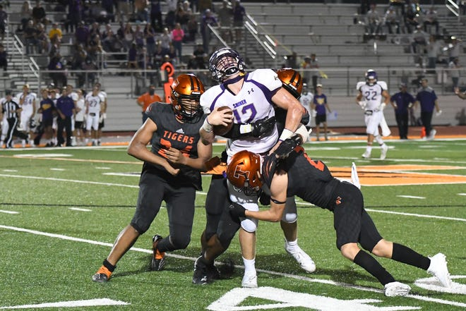 Members of the Smithville secondary converge on a receiver during a 2020 contest against Shiner.