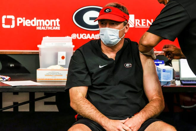 Georgia head coach Kirby Smart receives a COVID-19 vaccine administered by Piedmont Regional Healthcare at the Butts-Mehre Heritage Hall in Athens, Ga., on Saturday, March 27, 2021. (Photo by Tony Walsh)
