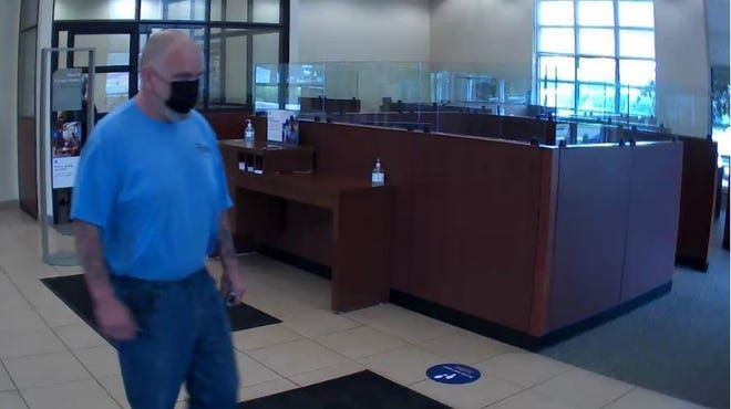 Akron police are seeking information on this man in connection with the robbery of a Chase bank in the city.