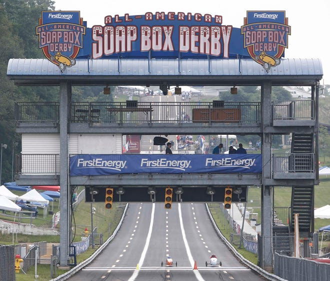 Champs complete their test run as they cross the finish line for the All-American Soap Box Derby at Topside at Derby Downs Tuesday, July 20, 2021 in Akron, Ohio.
