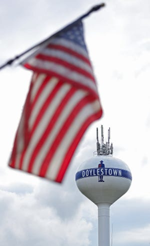 The Doylestown water tower is framed by an American flag.