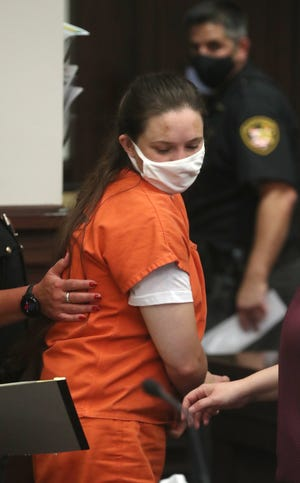 Erica Stefanko is led away Tuesday after being sentenced to life in prison, with possible parole after 30 years, for her role in the 2012 pizza-delivery murder of Ashley Biggs, in Summit County Common Pleas Judge Amy Corrigall Jones' courtroom in Akron.