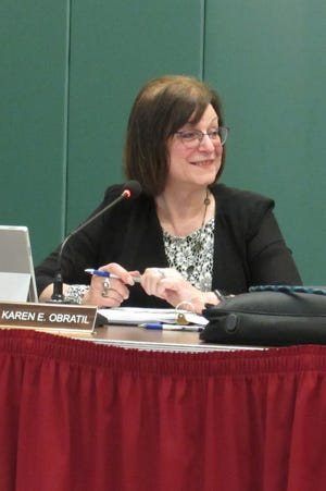 School Treasurer Karen Obratil gave her last treasurer's report at Monday night's school board meeting. She retires at the end of the month after nine years with the Nordonia Hills schools.