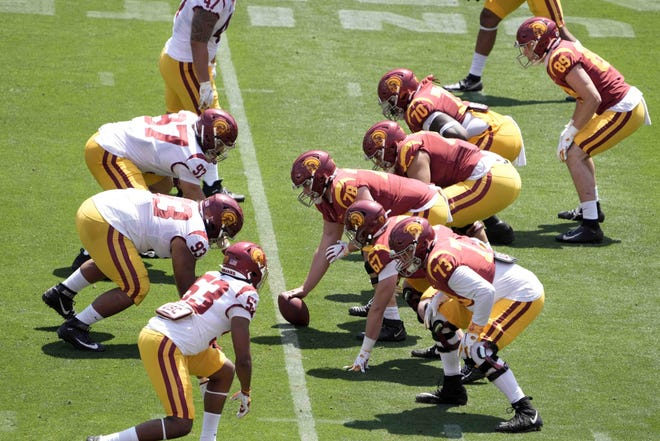 USC players prepare to snap the ball during the Trojans' spring game in April. USC has completely revamped its recruiting program in an effort to put it back among the nation's elite. USC signed the No. 1 overall recruit in the country in the 2021 class.