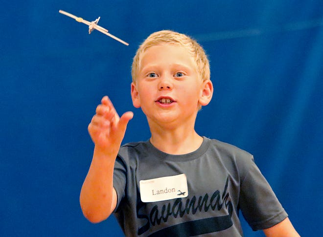 Landon Hickinbotham flies his toy glider while doing the center of gravity experiment with the gliders by placing paper clips at various points of the glider at Mr. Lee's Wings and Flying Things camp at Ashland Christian School on Tuesday, July 20, 2021. TOM E. PUSKAR/TIMES-GAZETTE.COM