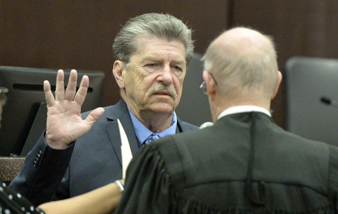 Augusta Commissioner John Clarke, left, takes the oath of office after being elected in 2018. Administering Clarke's oath is the late Juvenile Court Judge Douglas Flanagan. Clarke and Commissioner Catherine Smith McKnight are calling for the city to commission a citywide forensic audit and Clarke is calling to have the commission's oath of office read into the meeting record Tuesday.