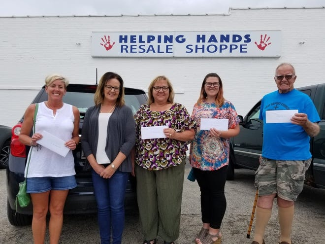 Canton Helping Hands Resale Shoppe presented $8,606 during the month of June to the following organizations with representatives pictured from the left: Brenda Shawgo representing St. Jude Runs; Wendy Mayall, Canton Helping Hands Resale Shoppe Store Manager; Patty Hoffman, Back to School Book Bash; Amanda Woodruff, Canton Main Street and John Grant representing First Baptist Food Pantry.
