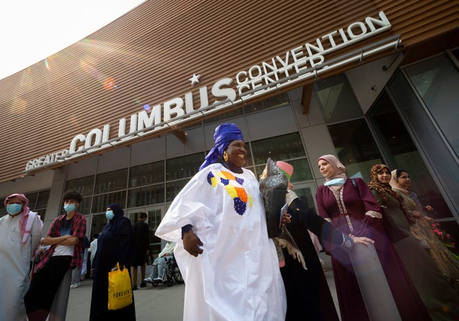Visitors leave following the Noor Islamic Cultural Center's annual Eid al-Adha prayer at the Greater Columbus Convention Center on Tuesday. Thousands of Muslim followers gathered for the prayer.