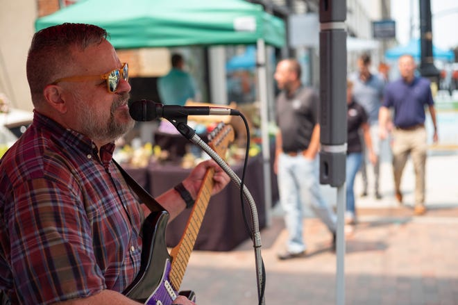 Todd Martin, of Portsmouth, sings with an acoustic version of his band Mothman, at Pearl Market on Tuesday.
