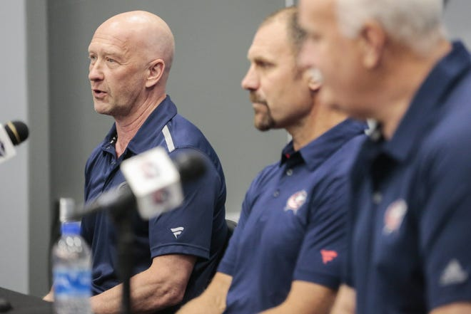 Blue Jackets general manager Jarmo Kekalainen, left, with coach Brad Larsen and president John Davidson, has three first-round draft picks to use on Friday, including the fifth overall.