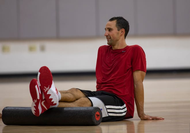 Aaron Craft, here stretching after a Carmen's Crew practice on Monday, begins his second year of medical school in August.