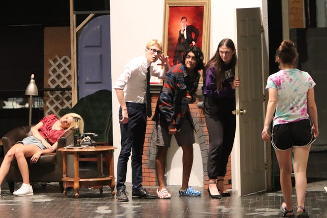 """Naomi Fridley (left) acts as a dead motorist as Leo Riley, Isahaan Gireesh and Mya Vandegrift work together to try and escape the scene during a rehearsal for the Wooster High School production of """"Clue."""" The play will be performed Thursday-Sunday at Wooster High School."""