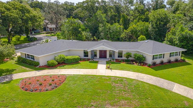 A circular driveway leads to this newly renovated Ormond Beach home, perched on a nearly half-acre corner lot.