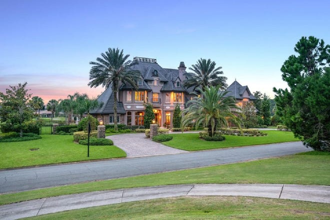 This multi-million-dollar masterpiece, tucked away on more than an acre in Ormond Beach's Plantation Bay, features a resort-style outdoor-living area and views of the 8th hole of the Preswick Golf Course.