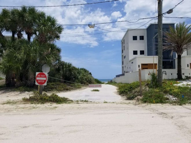 A sandy path to the ocean at New Smyrna Beach's 16th Avenue.
