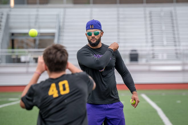 New Blue Springs High School assisant coach Keeston Terry works with players on a hands drill in a summer workout last week at Peve Stadium. Terry, an all-state receiver at Blue Springs, returns to his alma mater as the defensive coordinator under second-year head coach David White.