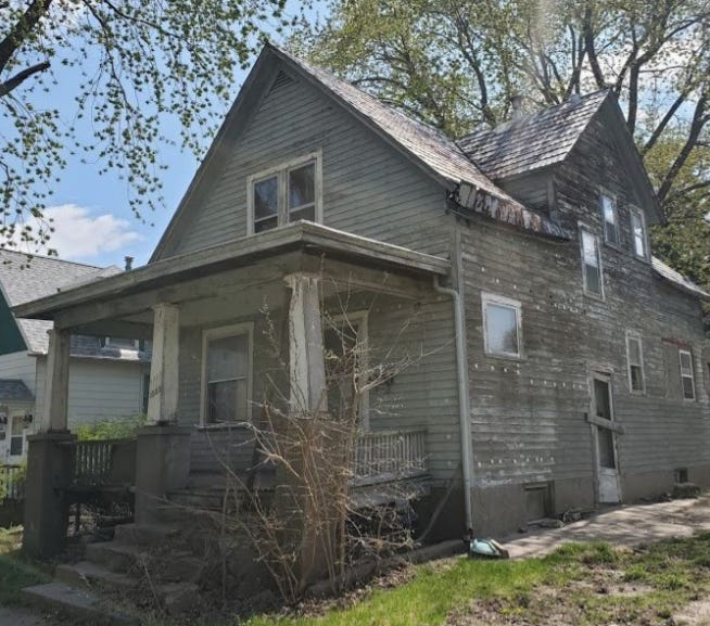 The home at 1323 Angular St. is in need of upgrades to its electrical and plumbing systems and new siding. A neighbor alleges the property also has sewer issues and has been claimed by a large number of bees.