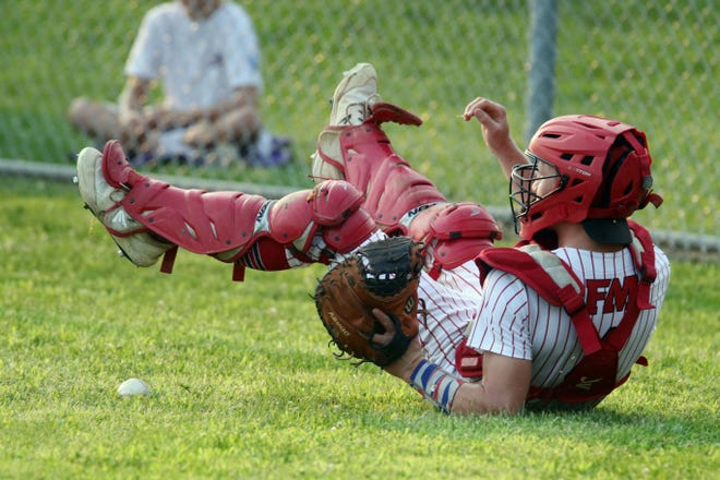 Fort Madison High School's Landes Williams (4) goes after a wild pitch that allowed a runner to score during their Class 3A Substate second round game against Central Dewitt Monday July 19, 2021, at Fort Madison High School.