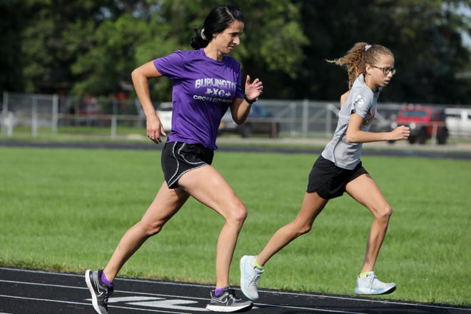 Amanda LaVeine, Burlington High School's new girls cross country coach takes part in a summer training session with her daughter Mylee Stiefel, 14, an eight grader at Ed Stone Middle School Tuesday July 20, 2021, at the BHS track.