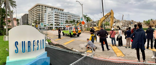 Two weeks after a large section of Champlain Towers South collapsed, and two days after the remaining section was brought down, media view the site from across Collins Avenue in Surfside.