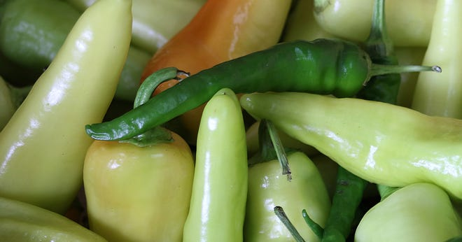 Fresh peppers for sale inside Mic's Mini Market on West May Avenue Tuesday afternoon, July 20, 2021.