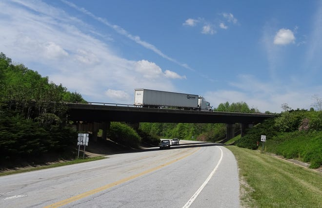 At the I-26 connecting highway's Exit 5 near Tuxedo, tall bridges and busy highways now cross over Frog Level, just as Uncle Mont predicted.