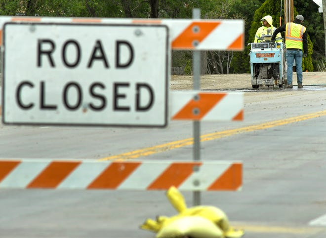 """The work on Jennie Barker Road is nearly completed with """"Road closed"""" signs having been removed and the stretch of road south of the Kansas Highway 156 intersection being open for use."""