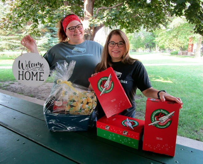 Courtney (Emerick) Morrison, left, and Shelly Emerick, representing Operation Christmas Child outreach, are shown with some of the raffle items that have been donated and will be awarded in drawing at the upcoming Craft and Vendor Fair that benefits Operation Christmas Child. Shelly Emerick also shows some of the shoeboxes that need to be filled for the effort to be a success