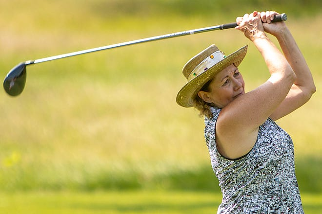 Lorie Larsen watches her drive from the 13th tee at Bunker Links during the opening round of the Galesburg Women's All-City Golf Tournament on Tuesday, July 20, 2021.