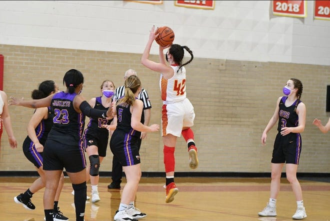 Mallory Wheeler looks to shoot a basket in a basketball contest.