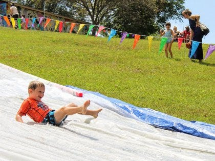 Slip 'N Foam is back at Butler Park for 2021 on Aug. 7. Volunteers will help with setup and tear down as well as all activity stations. They even get a free ride on the Slip 'N Slide.