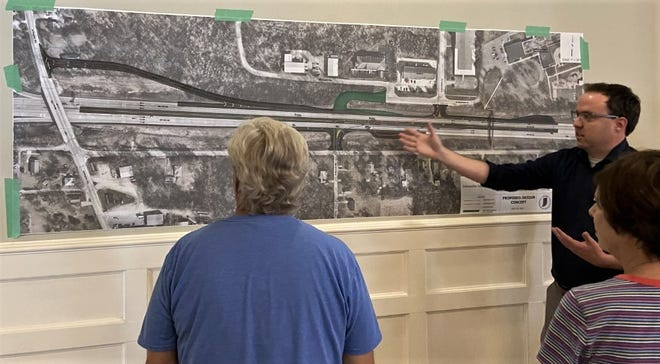 At a meeting Monday evening at North Central Church of Christ in Bloomington, Josh Iddings, environmental project manager of American Structurepoint, talks about the planned construction project on the Ind. 45/46 Bypass near Interstate 69.