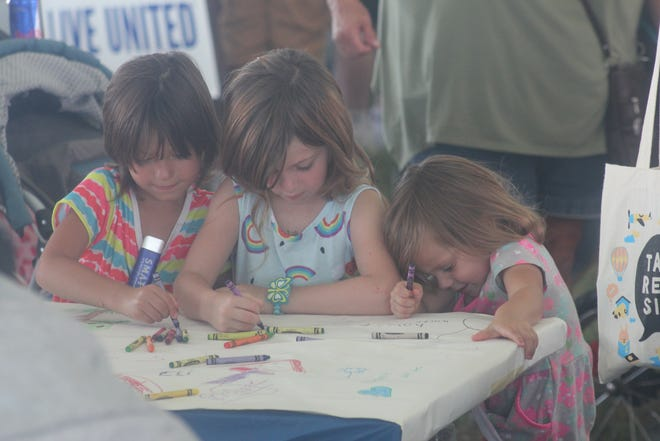Hundreds of children, their families and volunteers gathered on Tuesday, July 20, at the Bud LightE!Parkat the Ionia Free Fair for Kids Day. The event offereda variety of free events forchildren, ending with a bike raffle.