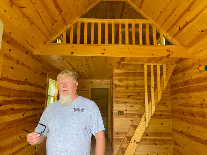 Vaughn Anderson walks through the 800-square-foot house Tuesday morning.