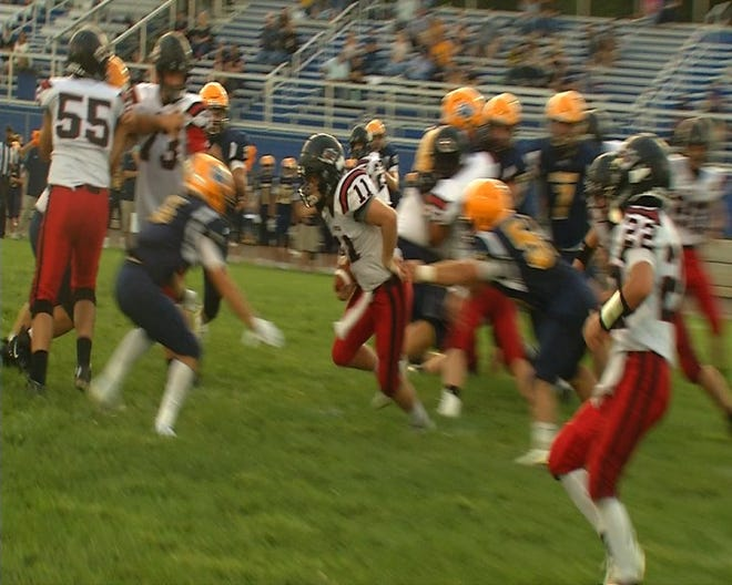 Running back Isaiah Casto (11) will return this season for the Ravenswood Red Devils. He led the Devils in rushing a year ago.