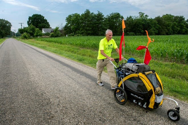 In this Journal Star file photo from 2016, Dean Troutman of Princeville is shown nearly halfway through his 700-mile trek across Illinois to raise money for a community park in Princeville to honor his late wife.